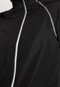 ONLY PLAY Tall - ONPPERFORMANCE RUN JACKET - Chaqueta de entrenamiento - black - 3