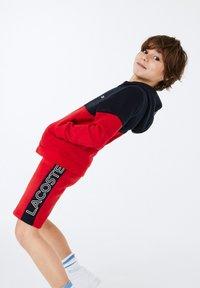 Lacoste Sport - veste en sweat zippée - bleu marine / rouge / blanc - 1