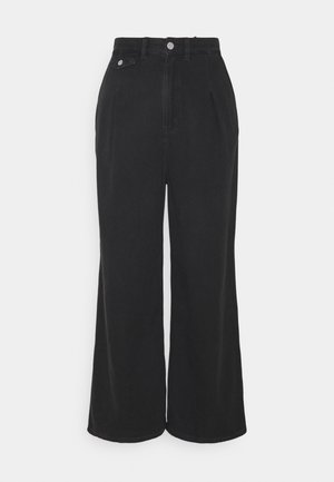 NANI TROUSERS - Flared jeans - black dark asia