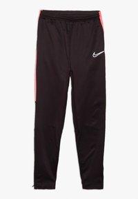 Nike Performance - ACADEMY WINTERIZED - Tracksuit bottoms - burgundy ash/racer pink/reflective silv - 0