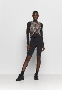 Hummel - SEAMLESS - Shorts - black - 1