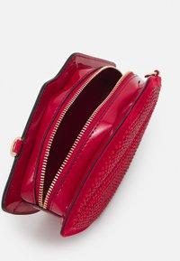 ALDO - JERAECIA - Across body bag - mars red - 2