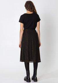 Indiska - ROS LUREX - A-line skirt - black - 7