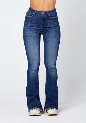 O-LIV  - Flared Jeans - dark-blue denim