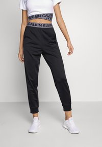 Calvin Klein Performance - PANT - Pantalon de survêtement - black - 0