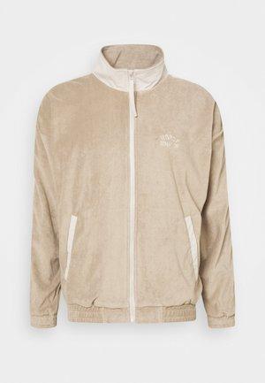 TRACK JACKET UNISEX - Zip-up hoodie - beige/off white