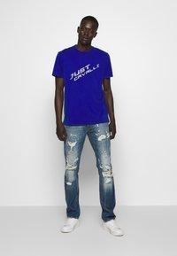 Just Cavalli - PANTS 5 POCKETS - Slim fit jeans - blue denim - 1