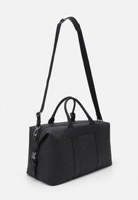 Michael Kors - DUFFLE UNISEX - Weekend bag - black - 1