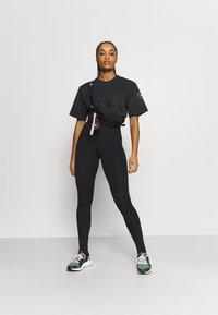 adidas by Stella McCartney - CROP TEE - T-shirt print - black - 1