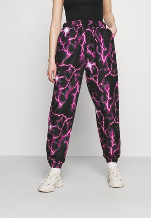 LIGHTENING JOGGER - Verryttelyhousut - black