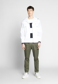 Tommy Hilfiger - LIGHT WEIGHT HOODED  - Summer jacket - white - 1