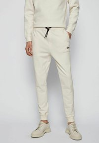BOSS - Tracksuit bottoms - natural - 0