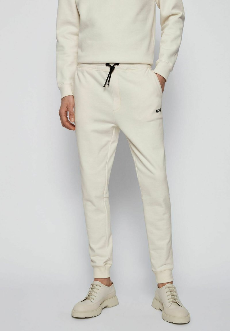 BOSS - Tracksuit bottoms - natural