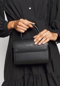 KARL LAGERFELD - IKON MINI TOP HANDLE - Across body bag - black - 0