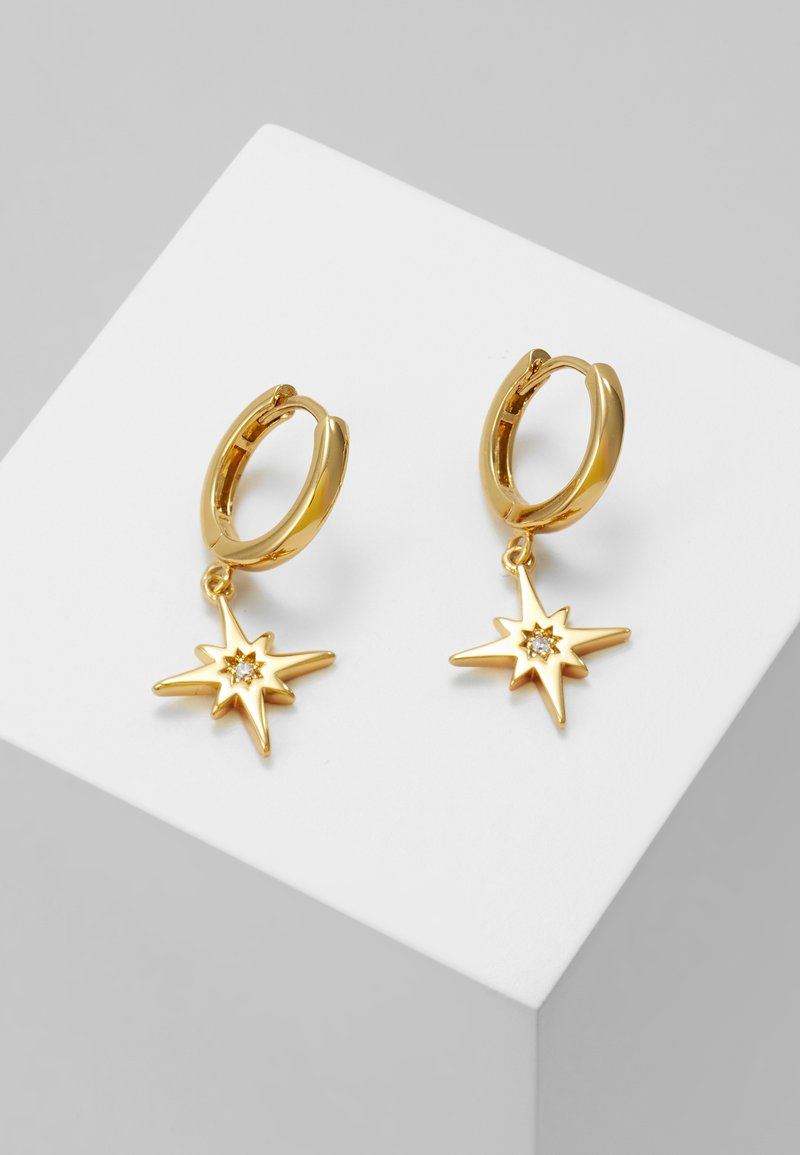 Orelia - STARBURST CHARM HUGGIE HOOPS - Earrings - gold-coloured