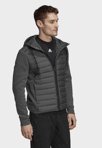 adidas Performance - VARILITE HYBRID  - Sports jacket - green - 4