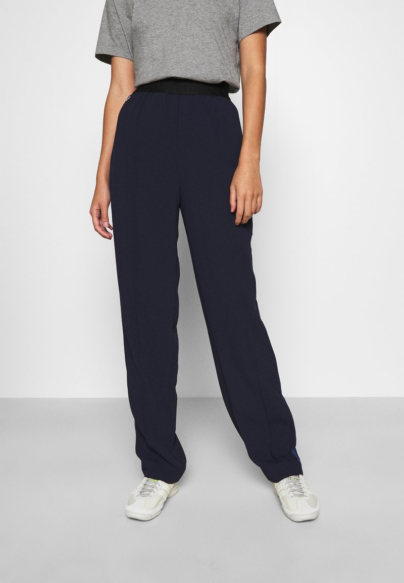Lacoste - Trousers - navy blue