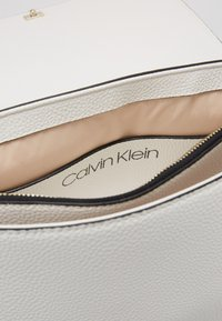 Calvin Klein - SIDED TOP HANDLE - Handbag - white - 5