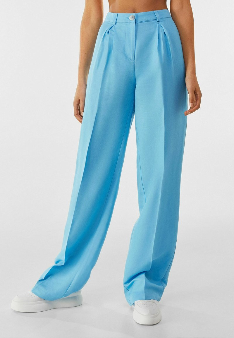 Bershka - Trousers - turquoise