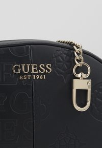 Guess - KAYLYN MINI CROSSBODY TOP ZIP - Handbag - black - 4