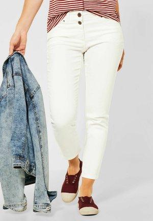 MIT STICKEREI - Slim fit jeans - beige