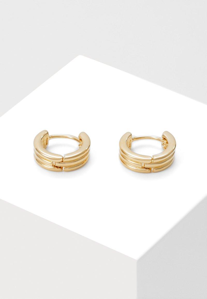 Orelia - RIDGED HUGGIE HOOPS - Earrings - pale gold-coloured