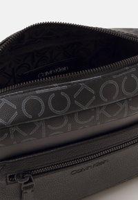 Calvin Klein - CAMERA BAG MONO UNISEX - Across body bag - black - 2