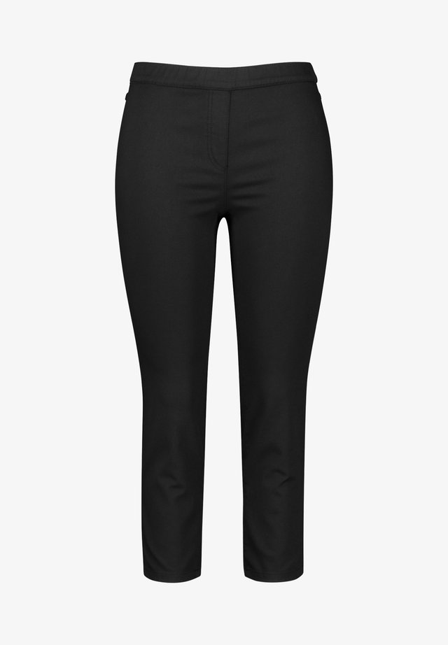 LUCY - Trousers - black