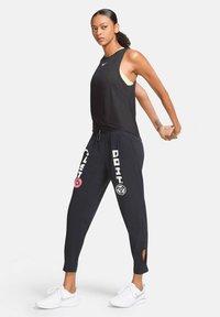 Nike Performance - ICON CLASH - Funkční triko - schwarz - 1
