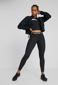 Nike Performance - Legginsy - black - 1