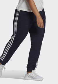 adidas Performance - ADIDAS ESSENTIALS FRENCH TERRY 3-STRIPES PANTS (PLUS SIZE) - Tracksuit bottoms - legink/white - 2