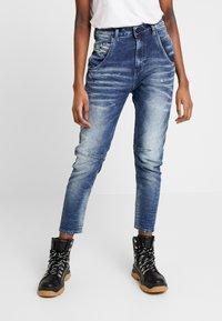 Diesel - FAYZA-NE JOGGJEANS - Relaxed fit jeans - indigo - 0