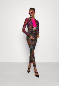 Versace Jeans Couture - PANTS - Leggings - Trousers - black - 1
