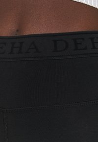 Deha - LEGGINGS 3/4 - 3/4 sports trousers - black - 3
