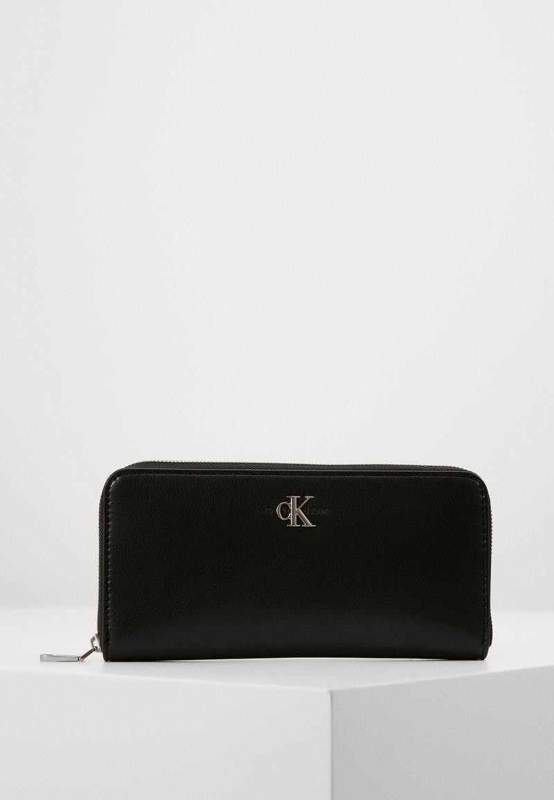 Calvin Klein Jeans - ZIP AROUND - Lommebok - black