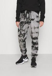 YOURTURN - Pantalones deportivos - black - 0