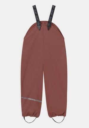 RAINPANTS SOLID UNISEX - Rain trousers - mahogany