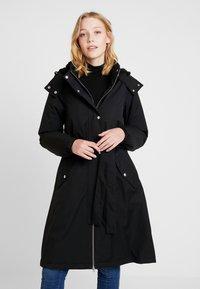 Danefæ København - BORNHOLM RAINCOAT - Waterproof jacket - black - 0