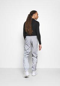 Hi-Tec - GRAHAM REFLECTIVE TRACK PANTS - Tracksuit bottoms - silver - 2