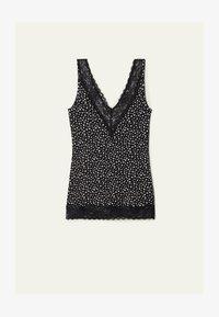 - 986t - black small flower print