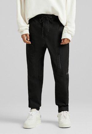 FUNCTIONAL - Cargo trousers - black