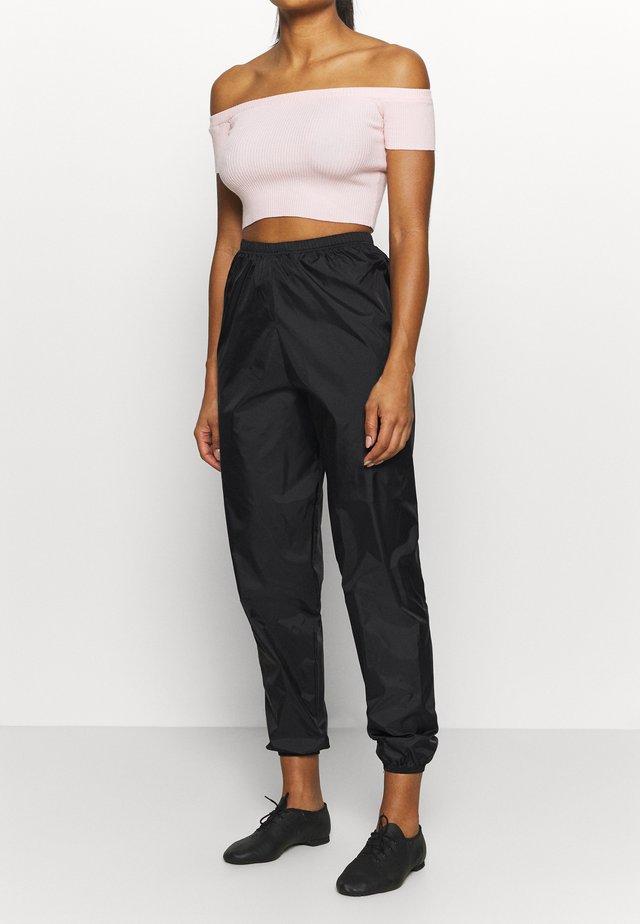 STOP PANT - Pantalones deportivos - black