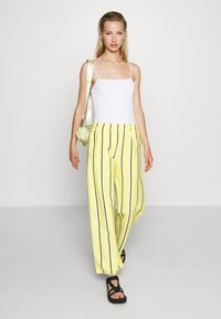 Obey Clothing - RONNY PANTS - Tracksuit bottoms - lemon multi - 1