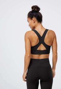 OYSHO - Medium support sports bra - black - 2