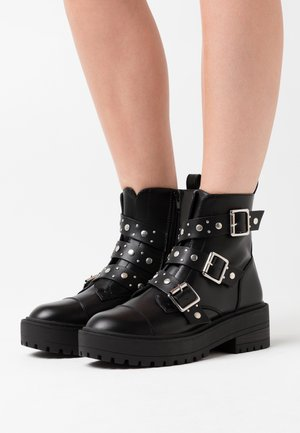 ONLBRANDY-3 BUCKLE - Cowboy/biker ankle boot - black