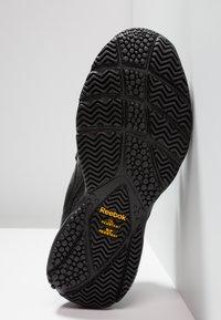 Reebok - WORK N CUSHION 3.0 - Neutral running shoes - black - 4