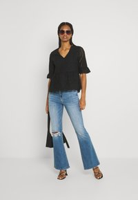 American Eagle - SUPER HIGH RISE - Flared Jeans - cool hand blue - 1