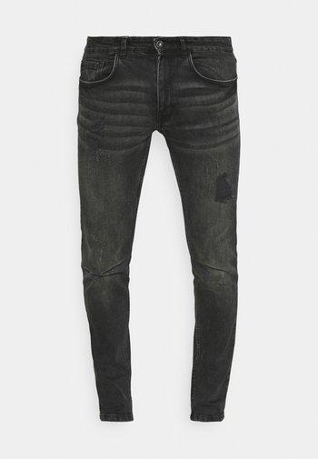 STOCKHOLM DESTROY - Jeans Tapered Fit - duke black