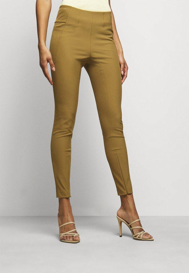 ADANIS - Leggings - Trousers - golden beige