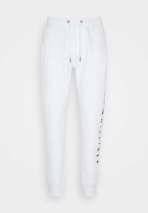 BASIC BRANDED - Tracksuit bottoms - white